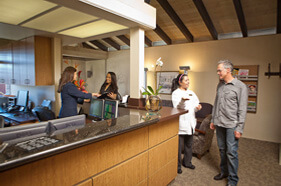 Patients and staff talking in office at La Jolla Dental Spa