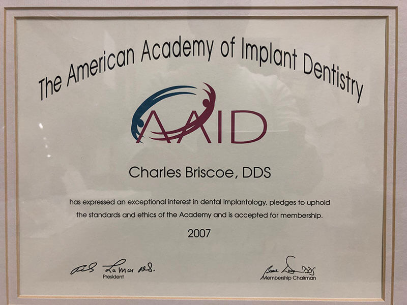 The American Academy of Implant Dentistry award for Dr. Charles Briscoe 2007